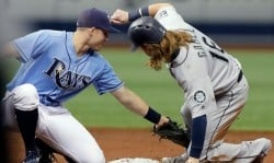 Ben Gamel is tagged trying to steal second in the Mariners' 3-0 loss Sunday to Tampa Bay. (AP)