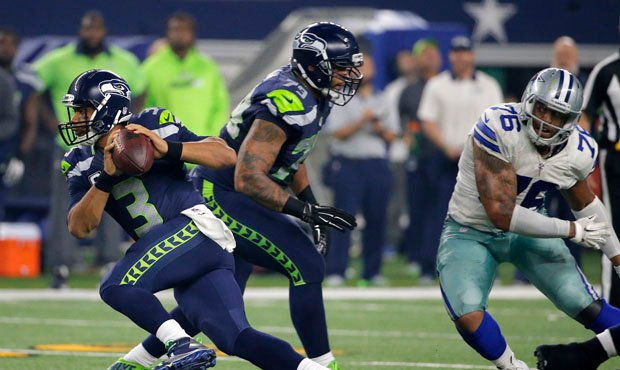 The Seahawks could consider moving Garry Gilliam to left tackle to replace Russell Okung. (AP)