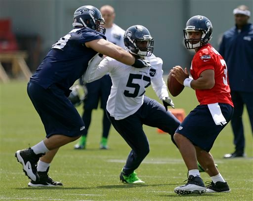 Seahawks Workouts Football - Ted S. Warren