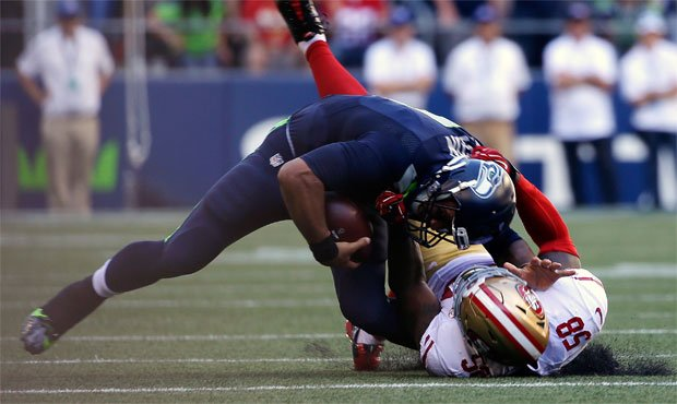 Seahawks coach Pete Carroll said an MRI revealed that Russell Wilson has a sprained MCL. (AP)...