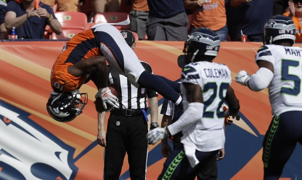 Denver's Emmanuel Sanders flips into the end zone for a touchdown against the Seahawks. (AP)...