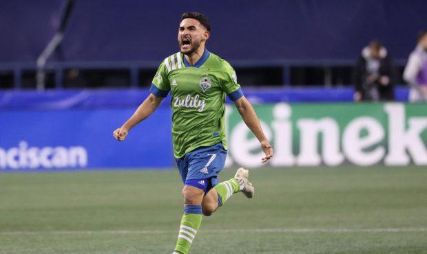 SEATTLE, WASHINGTON - DECEMBER 07: Cristian Roldan #7 of Seattle Sounders celebrates a goal by Gust...