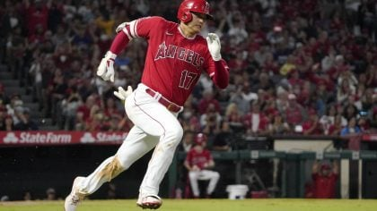 Los Angeles Angels designated hitter Shohei Ohtani rounds first on his way to a triple during the t...